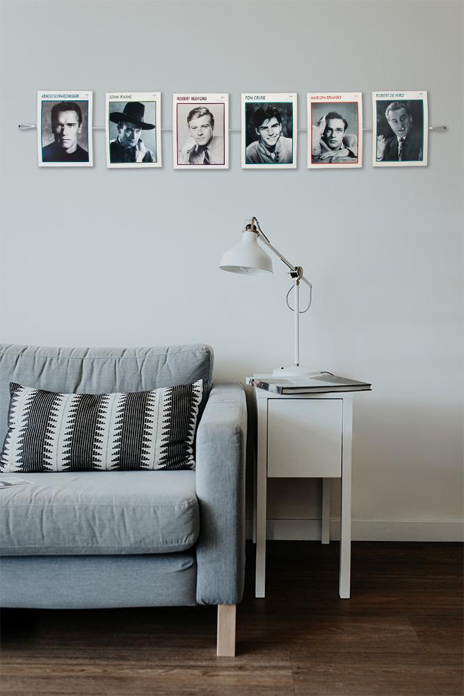 Postkarten und Fotos mit Fotoseil an der Wand aufhängen