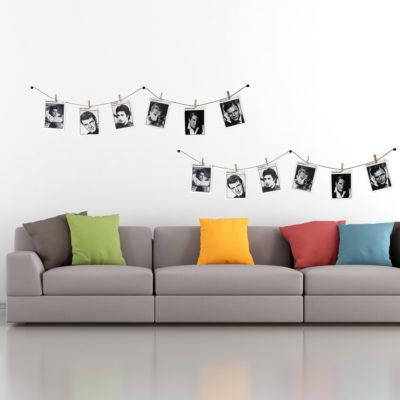 Fotos auf Fotoleine mit Klammern aufgehängt im Wohnzimmer