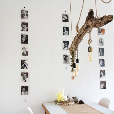 Vertikale Fotoseile in verschiedenen Längen halten Fotos und Postkarten